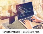 a programmer typing source... | Shutterstock . vector #1108106786