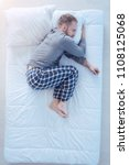 cozy sleep. top view on a young ... | Shutterstock . vector #1108125068