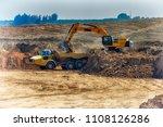 earthmover loads the ground in... | Shutterstock . vector #1108126286