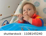 8 month baby  eating a turkey... | Shutterstock . vector #1108145240