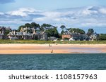 people walk along the shore of... | Shutterstock . vector #1108157963