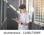 young doctor is checking the... | Shutterstock . vector #1108173089
