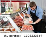 professional butcher arranging... | Shutterstock . vector #1108233869