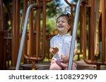 cute happy little girl playing... | Shutterstock . vector #1108292909