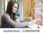 cute adult young woman sitting...   Shutterstock . vector #1108306598