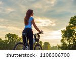 young woman with a bike in a...   Shutterstock . vector #1108306700