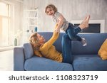 mom and child are laughing on... | Shutterstock . vector #1108323719