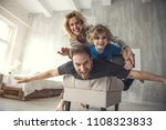 exited father is lying on pouf... | Shutterstock . vector #1108323833