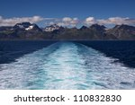Wall of towering mountain peaks on Lofoten islands in Norway from the local ferry - stock photo