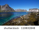 Panorama with old fishing port by the fjord on Lofoten islands in Norway - stock photo