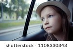 little girl looking out from... | Shutterstock . vector #1108330343