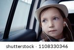 little girl looking out from... | Shutterstock . vector #1108330346