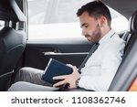 a young businessman arranges... | Shutterstock . vector #1108362746