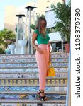 girl in the colorful steps of... | Shutterstock . vector #1108370780