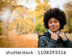 mixed race teen girl with eyes... | Shutterstock . vector #1108393316