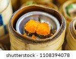 small steamer basket of seaweed ...   Shutterstock . vector #1108394078