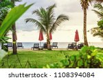 group of sunbeds and parasols... | Shutterstock . vector #1108394084