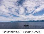 the ship sails along lake baikal | Shutterstock . vector #1108446926