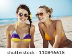 two young females at the beach | Shutterstock . vector #110846618
