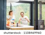 young couple drinking coffee... | Shutterstock . vector #1108469960