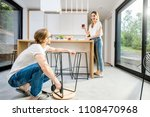 young couple doing house chores ... | Shutterstock . vector #1108470968