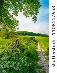 countryside footpath next to a... | Shutterstock . vector #1108557653