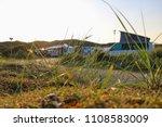 grass growing next to a road ... | Shutterstock . vector #1108583009