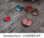 Ladybug Stone Painting On The...