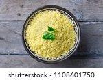 couscous in bowl. wooden... | Shutterstock . vector #1108601750