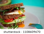 avocado on toast with eggs and... | Shutterstock . vector #1108609670