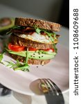 avocado on toast with eggs and... | Shutterstock . vector #1108609688