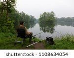 fisherman sitting on the chair... | Shutterstock . vector #1108634054