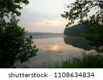 view on a lake during sunrise  | Shutterstock . vector #1108634834