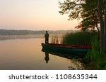 fisherman catching the fish... | Shutterstock . vector #1108635344