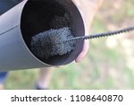 man cleaning chimney pipe... | Shutterstock . vector #1108640870