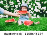 cutest smiling baby girl eating ... | Shutterstock . vector #1108646189