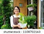 asian women working in a flower ... | Shutterstock . vector #1108702163