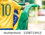 brazilian boy holding the flag... | Shutterstock . vector #1108713413