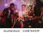 friends celebrating with fire... | Shutterstock . vector #1108764539