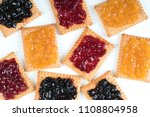 some dry biscuits with jam on a ... | Shutterstock . vector #1108804958