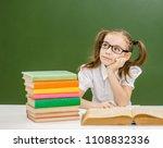 pensive little girl with books...   Shutterstock . vector #1108832336