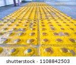 yellow braille brick tiles... | Shutterstock . vector #1108842503