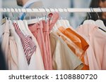 women clothing on hangers in a... | Shutterstock . vector #1108880720