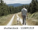 Stock photo young man with his dog 110891519