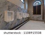 row of white ceramic urinal... | Shutterstock . vector #1108915538