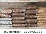 Stock photo row of animal feed pack or cereal and grain bags for pets on shelf in shop 1108931336
