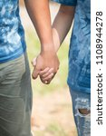 lovers holding hands in out... | Shutterstock . vector #1108944278