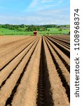 planting potatoes with a... | Shutterstock . vector #1108968374