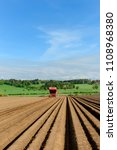 planting potatoes with a... | Shutterstock . vector #1108968380