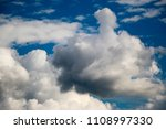 white clouds against the blue...   Shutterstock . vector #1108997330